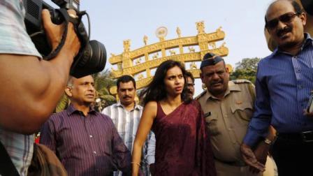 Diplomat Devyani Khobragade, center, arrives at Chaitya Bhoomi, a memorial to Indian freedom fighter B.R. Ambedkar, with her father Uttam Khobragade in Mumbai, India.