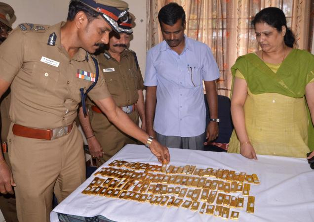 Additional Director General of Police, Coastal Security Group C.Sylendra Babu inspecting seized gold biscuits at Mandapam Marine Police station in Ramanathapuram district on Sunday. Photo: L. Balachandar