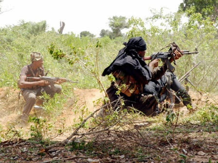 A group of Tamil Tiger rebels return fire at Akkarayan, a village in Kilinochchi during a confrontation with the Sri Lankan army circa 2008.