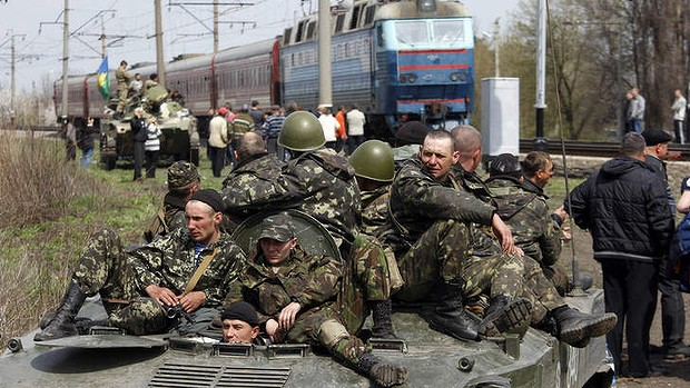 Pro-Russian activists block Ukrainian men riding on armoured combat vehicles. Photo: AFP