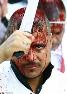 1415088202514_Image_galleryImage_An_Iraqi_Shiite_man_takes