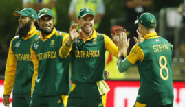 South Africa's AB De Villiers (2nd R) celebrates with team mate Dale Steyn after dismissing Zimbabwe's Soloman Mire out caught during their Cricket World Cup match in Hamilton, February 15, 2015.    REUTERS/Nigel Marple   (NEW ZEALAND - Tags: SPORT CRICKET)