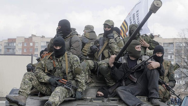 A combat vehicle with pro-Russian gunmen on top drives through Slaviansk. Photo: AP