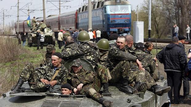 Pro-Russian activists block Ukrainian men riding on armoured combat vehicles. Photo: AFP